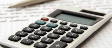 Picture of a calculator and pencil that could be used to work out tax payments